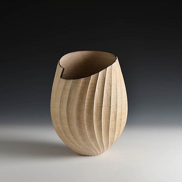 Oak turned and carved vessel by Liam Flynn (RIP)